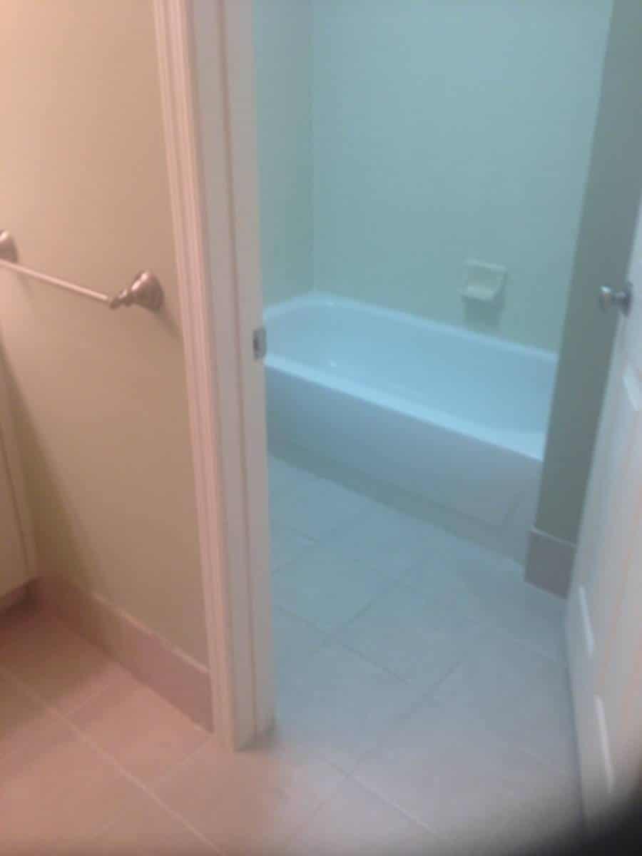 Clean Bathtub, Walls, and Tile Floors in Bathroom
